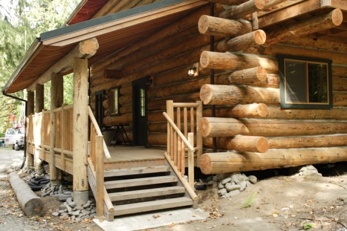 Log home built by couple porch