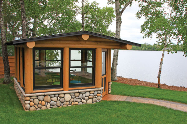 Log home at the lakeside gazebo