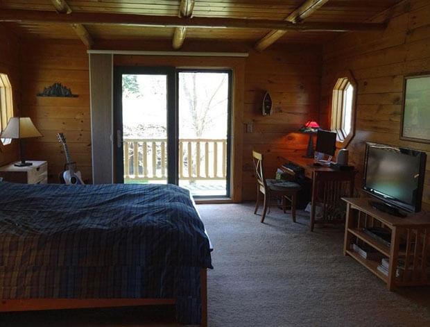 Natural log home bedroom