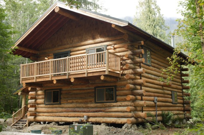 Log home built by couple balcony